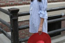 With red wide brim hat and lace up shoes