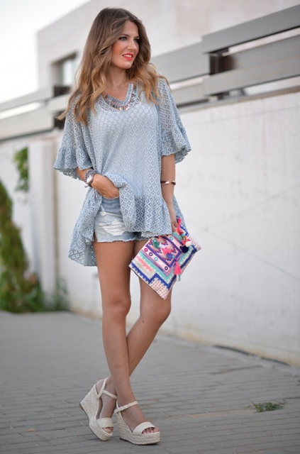 With ruffled shirt, distressed shorts and colorful clutch