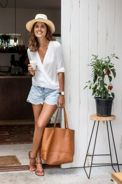 With shorts, hat, brown tote and brown sandals