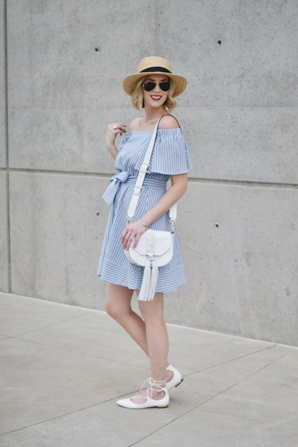 With straw hat, white bag and white lace up flats