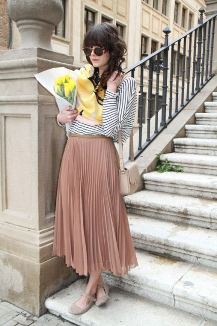 With striped blouse, beige bag and flat shoes