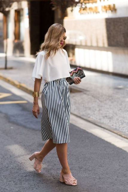 With striped culottes, printed clutch and pale pink mules