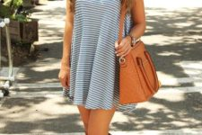 With striped dress and brown bag