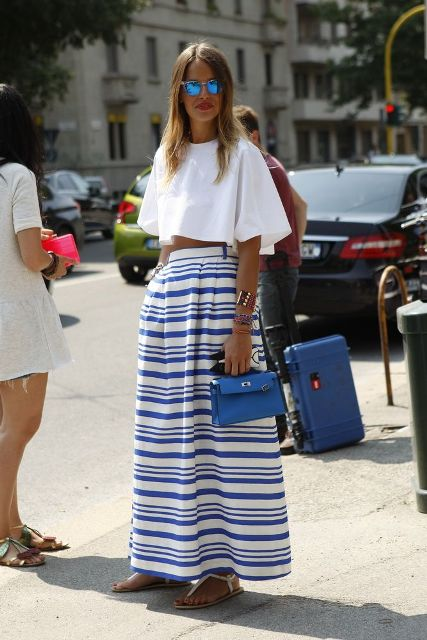 With striped maxi skirt, flat sandals and blue bag