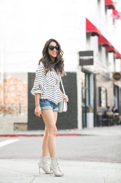With striped ruffled blouse, white bag and gray cutout boots