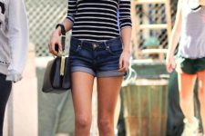 With striped shirt, black leather bag and brown shoes