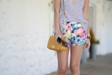With striped shirt, floral shorts and yellow bag