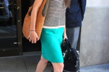 With striped shirt, pencil skirt and brown bag