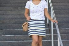 With striped skirt, white shoes and chain strap bag