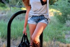 With t-shirt, denim shorts and black tote