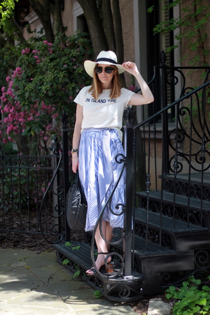 With t shirt, hat and ankle strap shoes