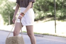 With t-shirt, white shorts and beige bag