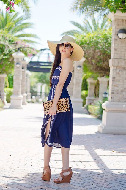 With white and blue dress, wide brim hat and leopard clutch