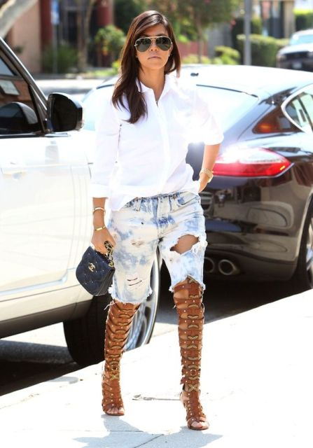 With white button down shirt, distressed denim shorts and mini bag