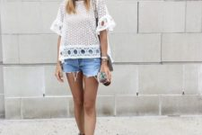 With white lace blouse and denim shorts