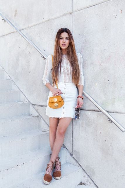With white lace blouse, mini skirt and yellow small bag