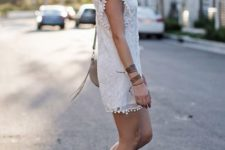 With white lace dress and beige bag