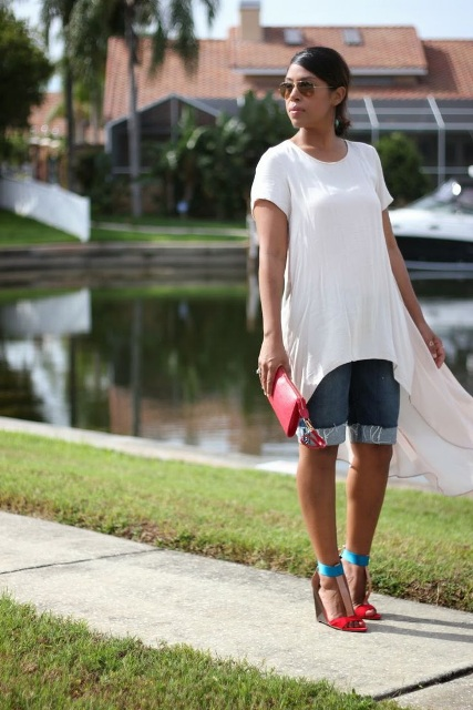 With white long shirt, red clutch and red and blue sandals