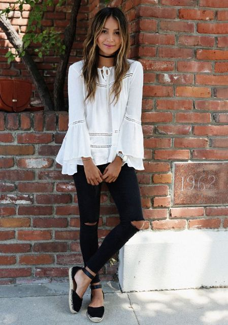 With white loose blouse and black distressed pants