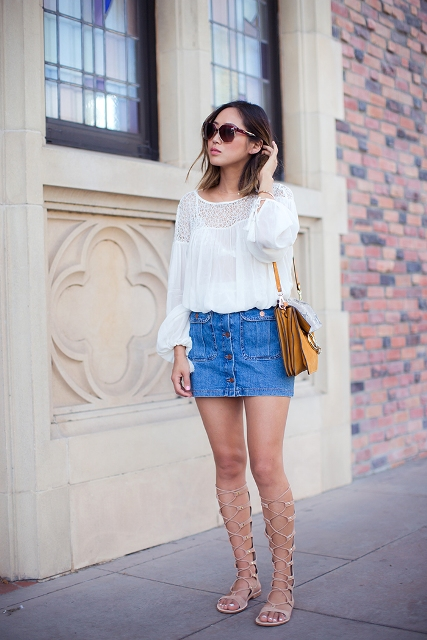 With white loose blouse, denim skirt and yellow bag