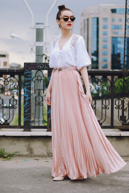 With white loose shirt, heels and belt