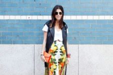 With white loose shirt, leather vest, orange clutch and cutout shoes