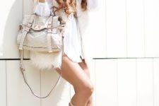 With white mini dress, fur vest and white bag