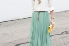 With white shirt, leopard belt, yellow clutch and beige shoes