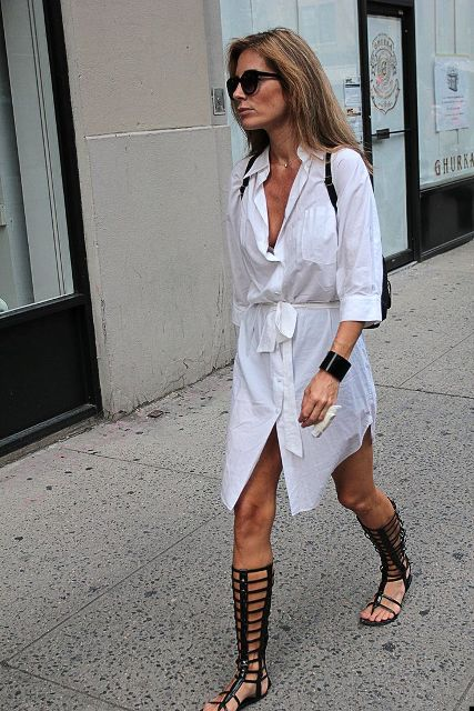 With white shirtdress and black backpack