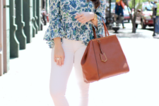 With white skinny pants, platform sandals and brown bag