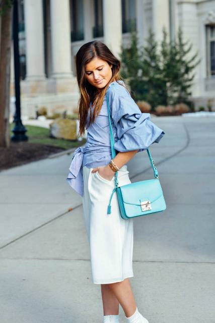 With white skirt, light blue bag and white shoes