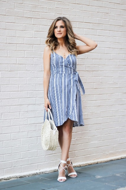 With white straw bag and white sandals