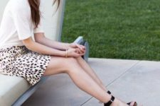 With white t-shirt and animal printed skirt