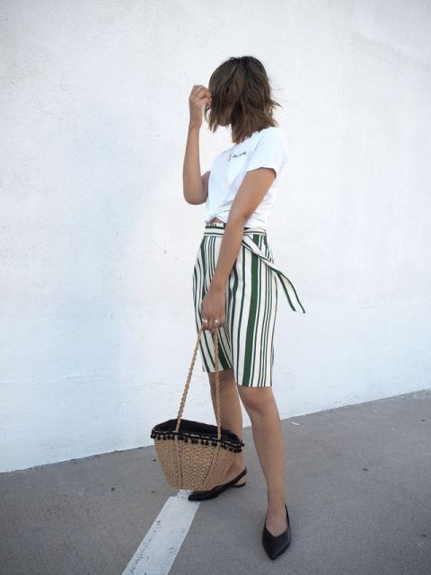 With white t-shirt, black flats and straw bag
