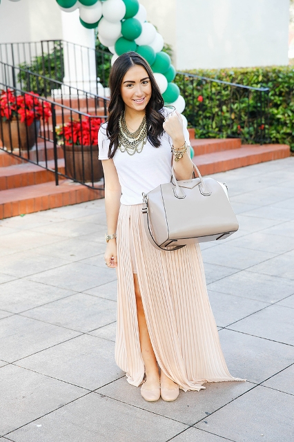 With white t shirt, gray bag and beige flats