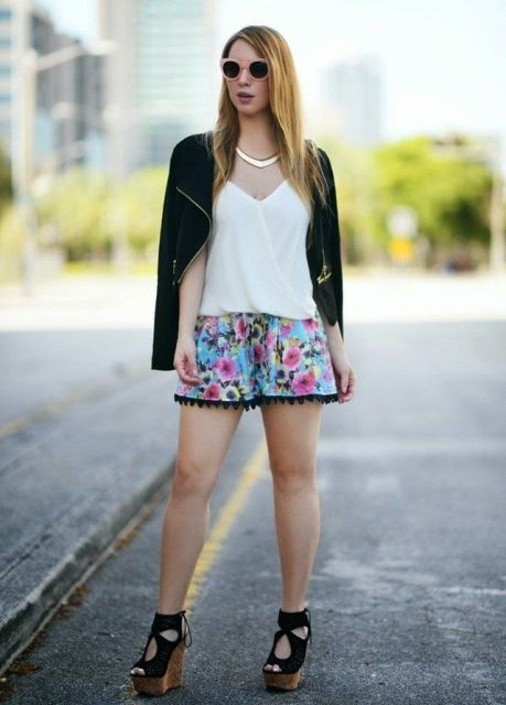 With white top, black blazer and floral shorts