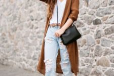 With white top, distressed jeans, brown long blazer and black bag