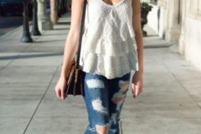 With white top, jeans and brown bag