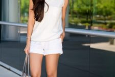 With white top, silver shoes and tote