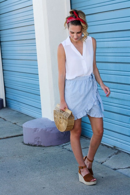 With white top, straw bag and wrap skirt