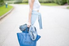 With white top, white pants and blue bag