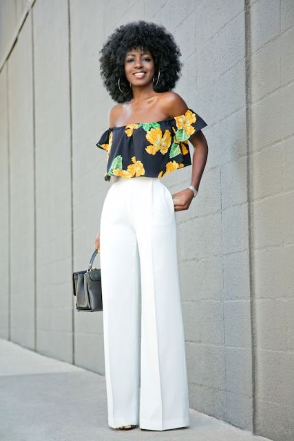 With white wide leg trousers and small bag