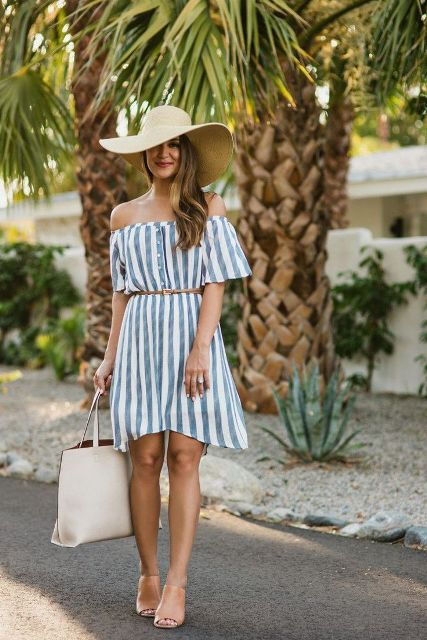 With wide brim hat, belt, beige mules and white tote