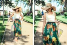 With wide brim hat, pastel colored top, tote and flat shoes