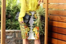 With yellow blouse, black bag and ankle strap shoes