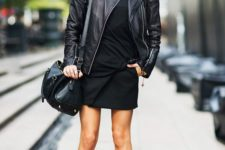 02 a black wrap mini skirt, a blakc tee, a black leather jacket, leopard bootes and a black bag