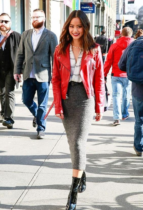 a checked shirt, a red leather jacket, a grey pencil midi skirt, black boots