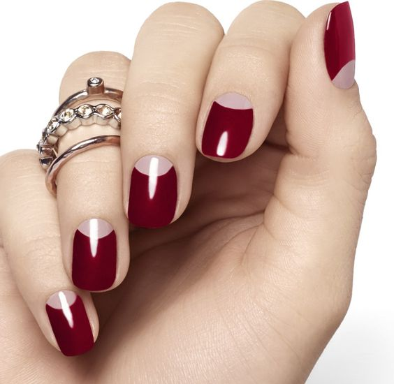 a classic half moon burgundy manicure for an elegant and refined touch to your look