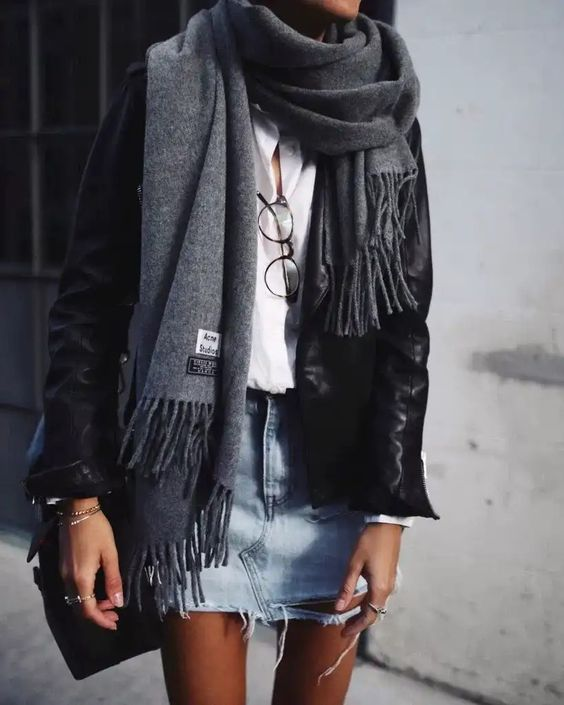 a distressed denim skirt, a white shirt, a black leather jacket and a grey scarf