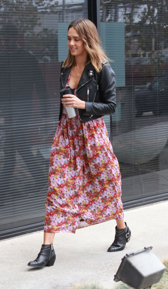 a floral midi dress, a black leather jacket, black booties for a boho feel
